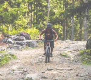 Mountain Biker skills with Electric MTB on the way down