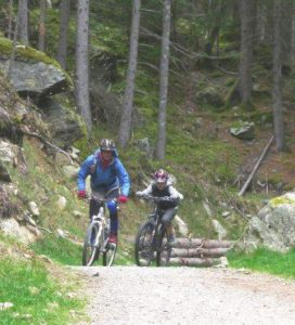 Mountain biking guide with is student riding some trails in Chamonix